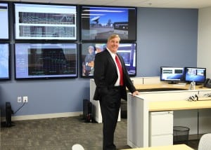 Bob Roe, CEO at TrustComm, at TrustComm's new Quantico facility.  Image credit: TrustComm