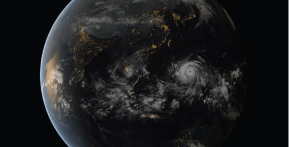 Composite image showing the colossal Typhoon Haiyan above the Philippines incorporating data captured by the geostationary satellites of the Japan Meteorological Agency (MTSat 2) and EUMETSAT (Meteosat 7), overlaying NASA's 'Black Marble' imagery. Photo: EUMETSAT.