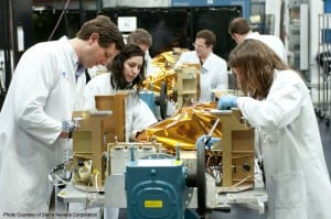 SNC engineers inspect OG2 spacecraft