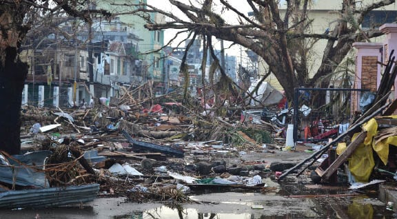 Debris lines the streets of Tacloban, Leyte island. This region was the worst affected by the typhoon, causing widespread damage and loss of life.  Photo: Eoghan Rice - Trócaire / Caritas