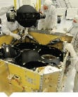 Engineers working on the WorldView 3 satellite.  Credit: Ball Aerospace