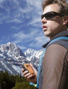 A man using SPOT satcom technology