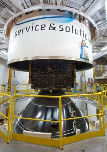 Ariane 5's payload fairing is lowered over THOR 7. The details this satellite's installation atop the SYLDA dispenser system.