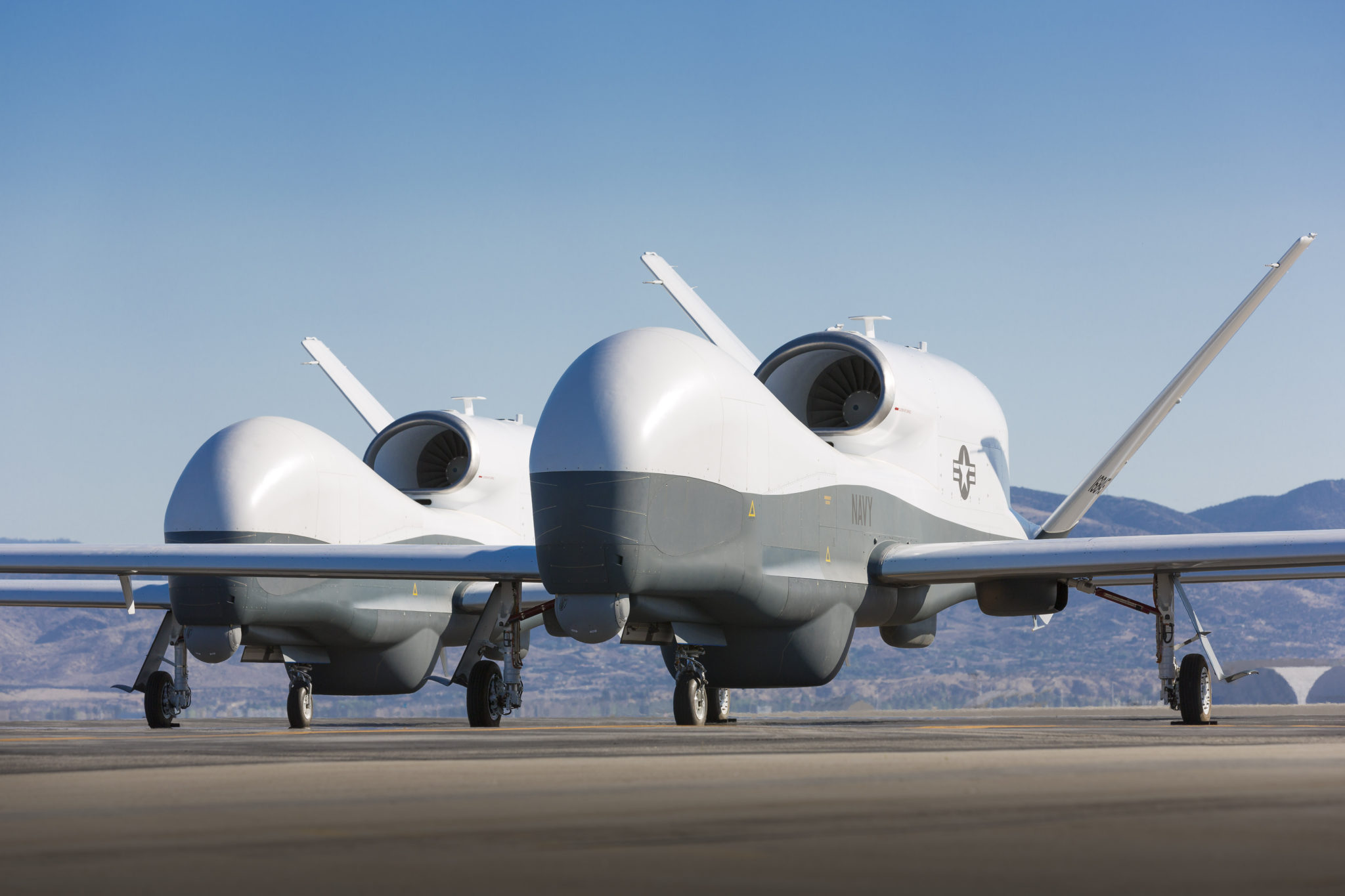 Two Northrop Grumman MQ-4C Triton unmanned aerial vehicles are seen on the tarmac at a Northrop Grumman test facility in Palmdale, Calif. Triton is undergoing flight testing as an unmanned maritime surveillance vehicle