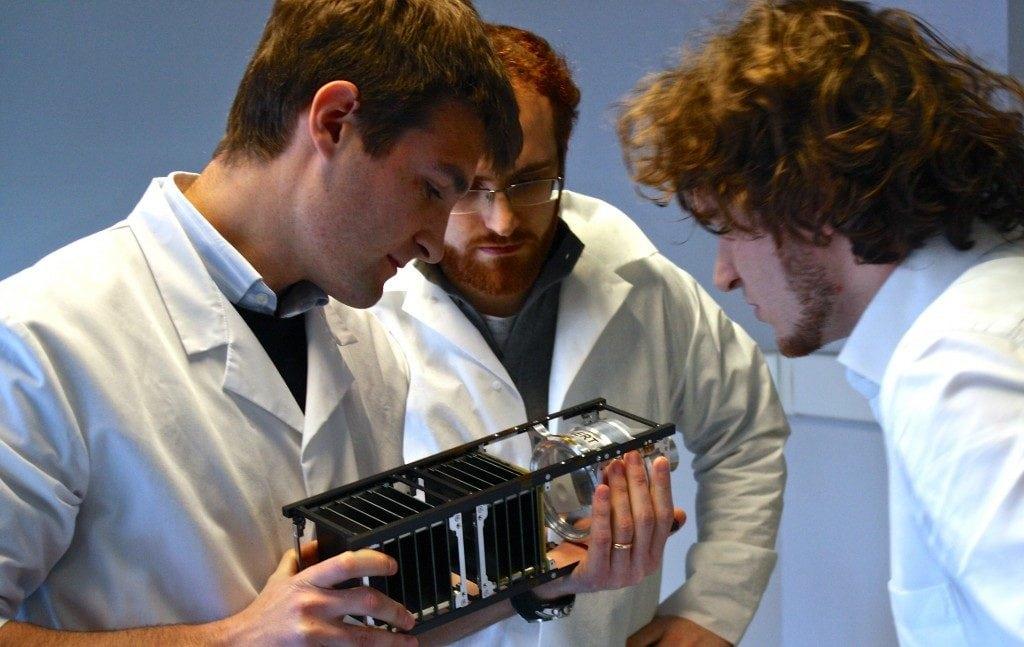 D-Orbit workers holding a cubesat. Photo: D-Orbit