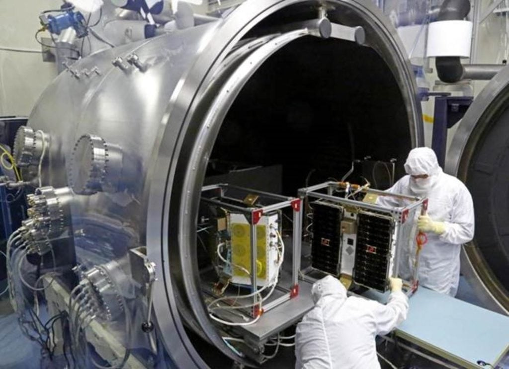 The first four out of eight CYGNSS spacecraft undergoing thermal/vacuum testing. Photo: University of Michigan