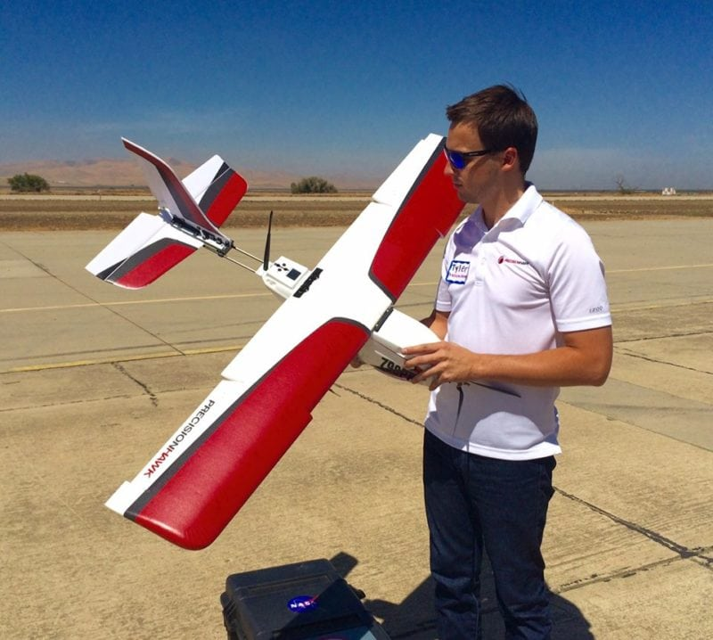 Tyler Collins, Vice President of Airspace Services - LATAS at PrecisionHawk, with the Lancaster drone.