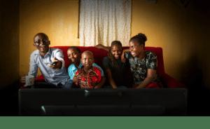 Family watching TV. Photo: Azuri Technologies