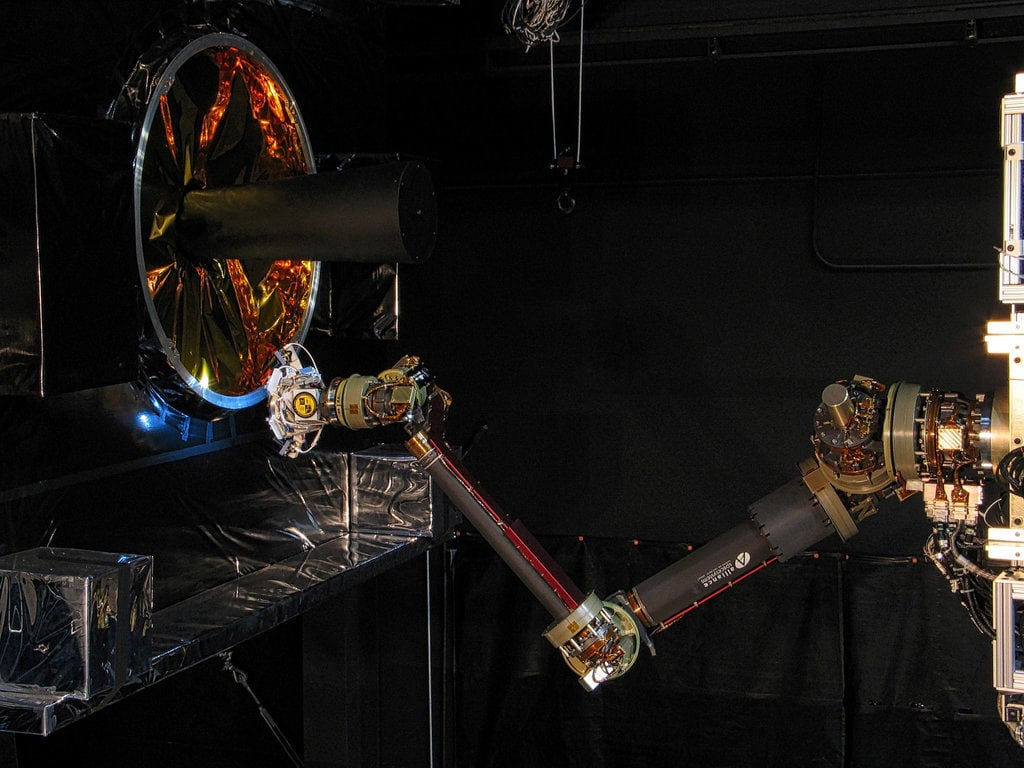 The Front-end Robotics Enabling Near-term Demonstration, or FREND, flight prototype robotic arm performs fully autonomous grapple testing. This testing demonstrates RSGS on-board processing's ability to track and guide a robotic arm to grapple a launch vehicle adapter ring (left) that is common to many spacecraft designs. Photo: U.S. Naval Research Laboratory (NRL)
