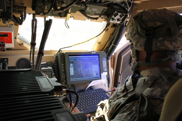 A soldier uses the Joint Capabilities Release of Force 21 Battle Command Brigade and Below/Blue Force Tracking.