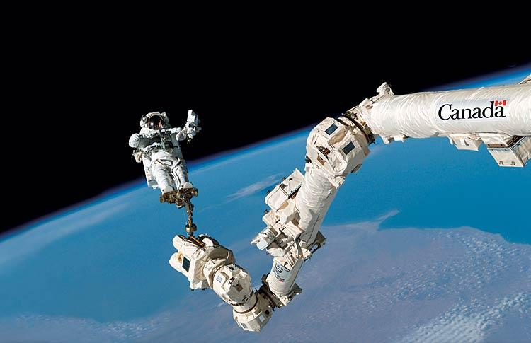 Astronaut Chris Hadfield attached to the Canadarm. Photo: NASA.