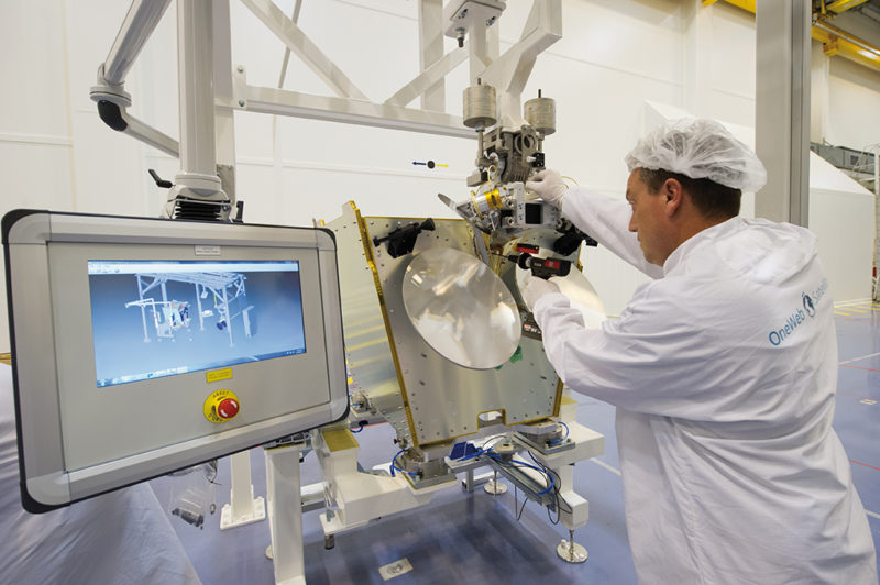 A worker completes tasks manually on the production line at OneWeb Satellite's new facility. Photo: OneWeb.