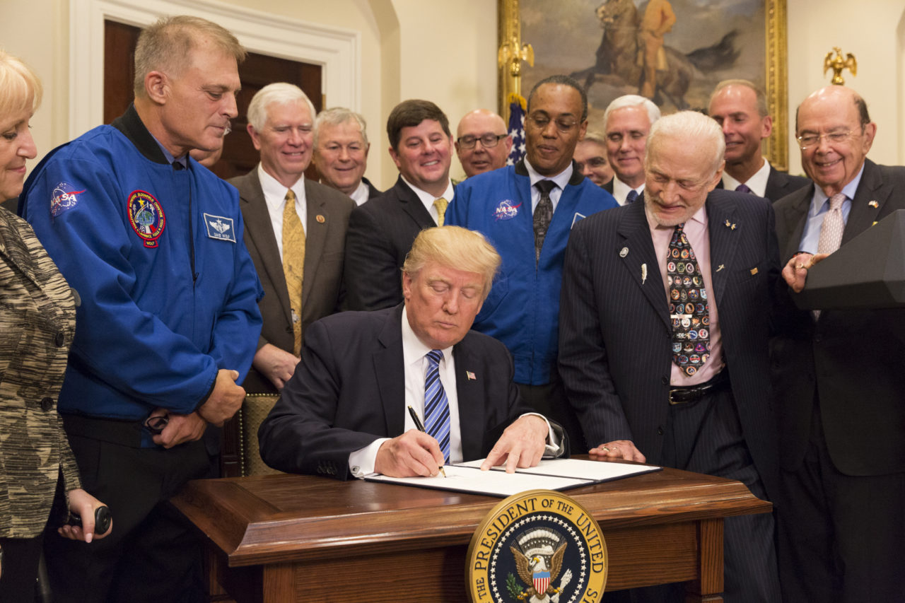 President Donald Trump signs the executive order reestablishing the National Space Council. Photo: The White House.