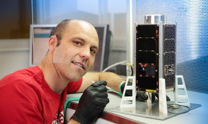 Inovor CEO Matthew Tetlow with the company's first CubeSat. Photo: Inovor/The Lead South Australia.