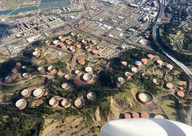 Floating oil storage drums. Photo: Flickr, Steve Jurvetson.