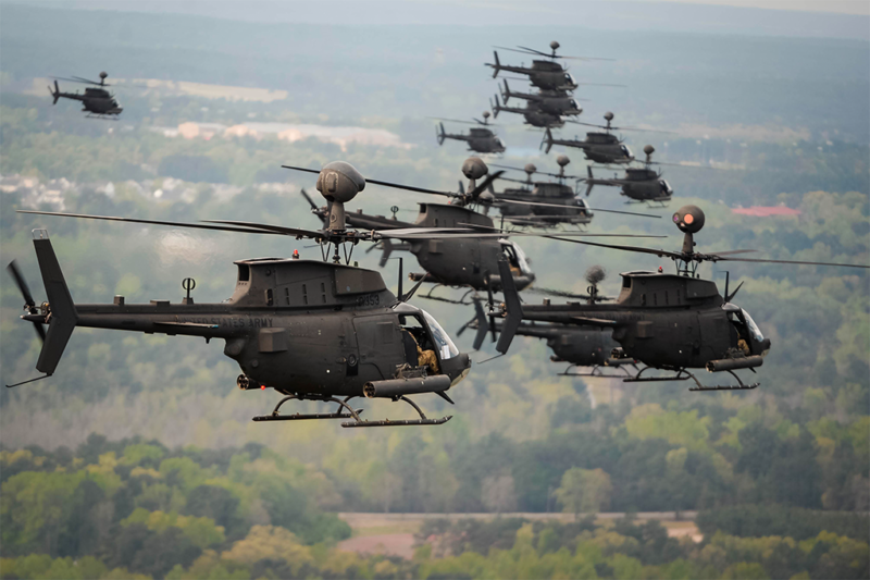 32 OH-58D Kiowa Warriors conduct a flyover above Fort Bragg, North Carolina. Photo: DOD, Kenneth Kassens.