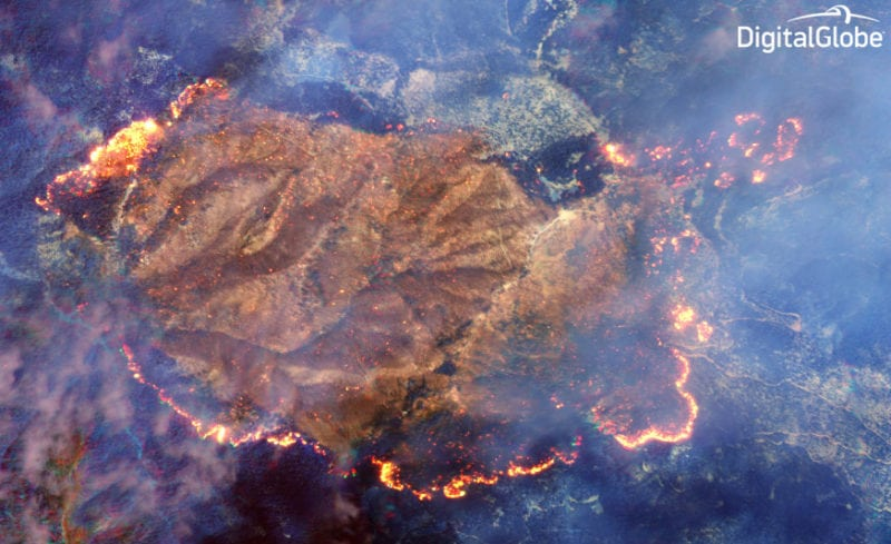 DigitalGlobe uses a Shortwave Infrared (SWIR) sensor built by Harris on its WorldView 3 satellite to penetrate the smoke and detect heat beneath. Photo: DigitalGlobe.