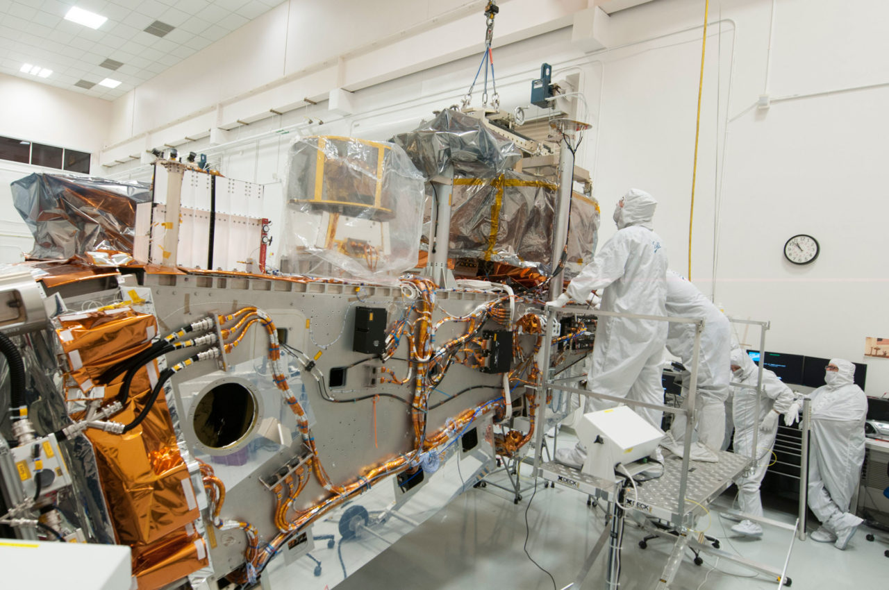 Ball and Raytheon technicians integrate the VIIRS Optical and Electrical Modules onto the JPSS 1 spacecraft. Credit: Ball Aerospace.