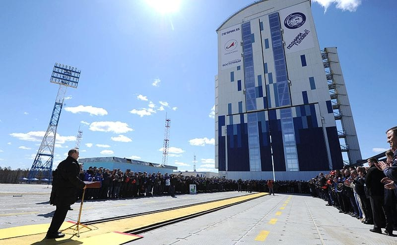 """Vladimir Putin, President of the Russian Federation, gives a speech at the launch of the Soyuz-2.1a from Vostochny on April 28, 2016. Visible is also Yuri Gagarin's face and slogan """"Raise your head!"""" to commemorate the 55th anniversary of Gagarin's flight."""