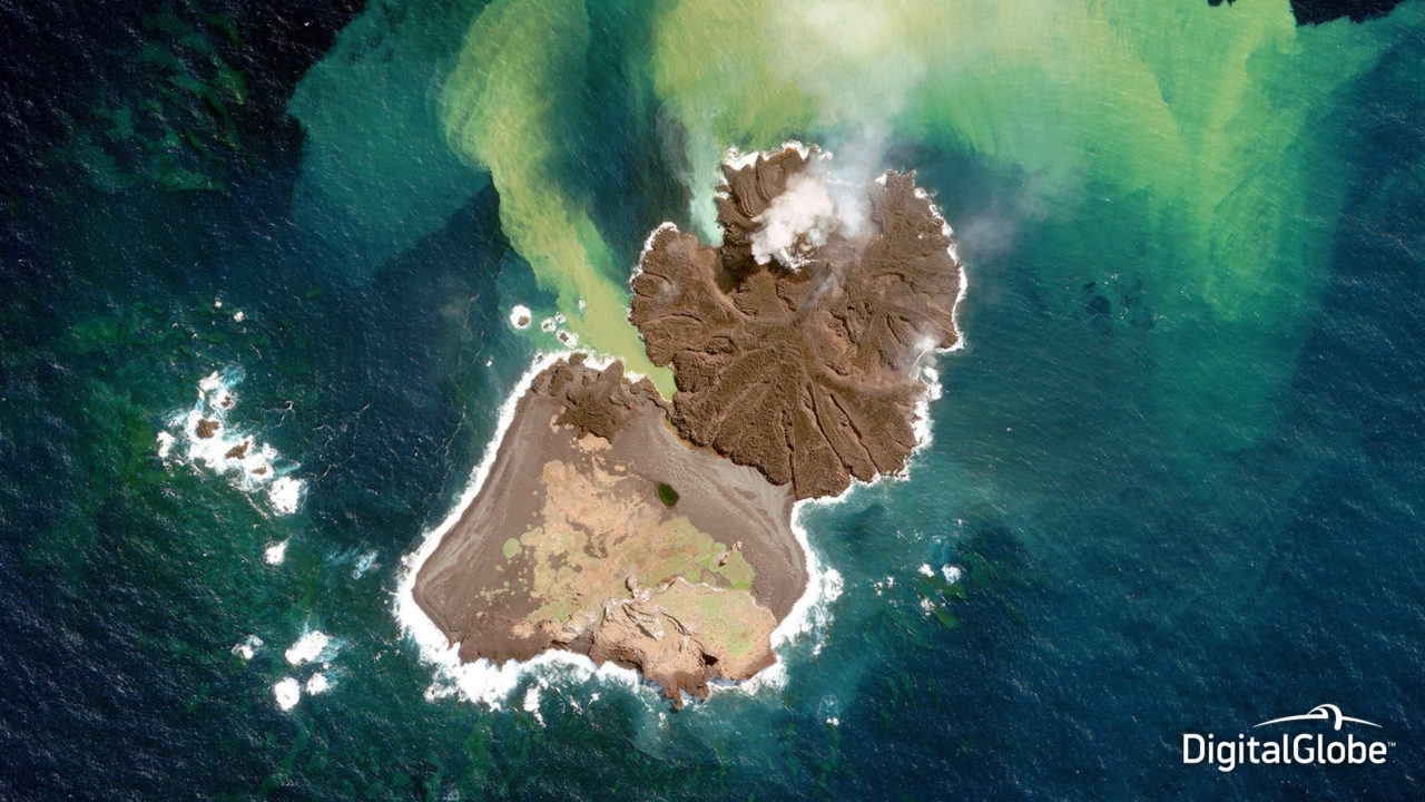 An island, Nishinoshima, rises out of the Pacific Ocean off the coast of Japan in this December 31, 2013 image captured by WorldView 2. Photo: DigitalGlobe.