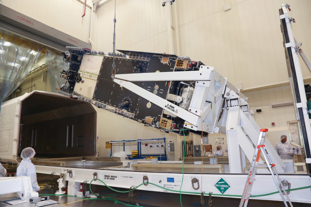 Lockheed Martin technicians loaded the Hellas-Sat 4/SaudiGeoSat 1 communications satellite into its shipping container for delivery to environmental testing in California. Photo: Lockheed Martin.