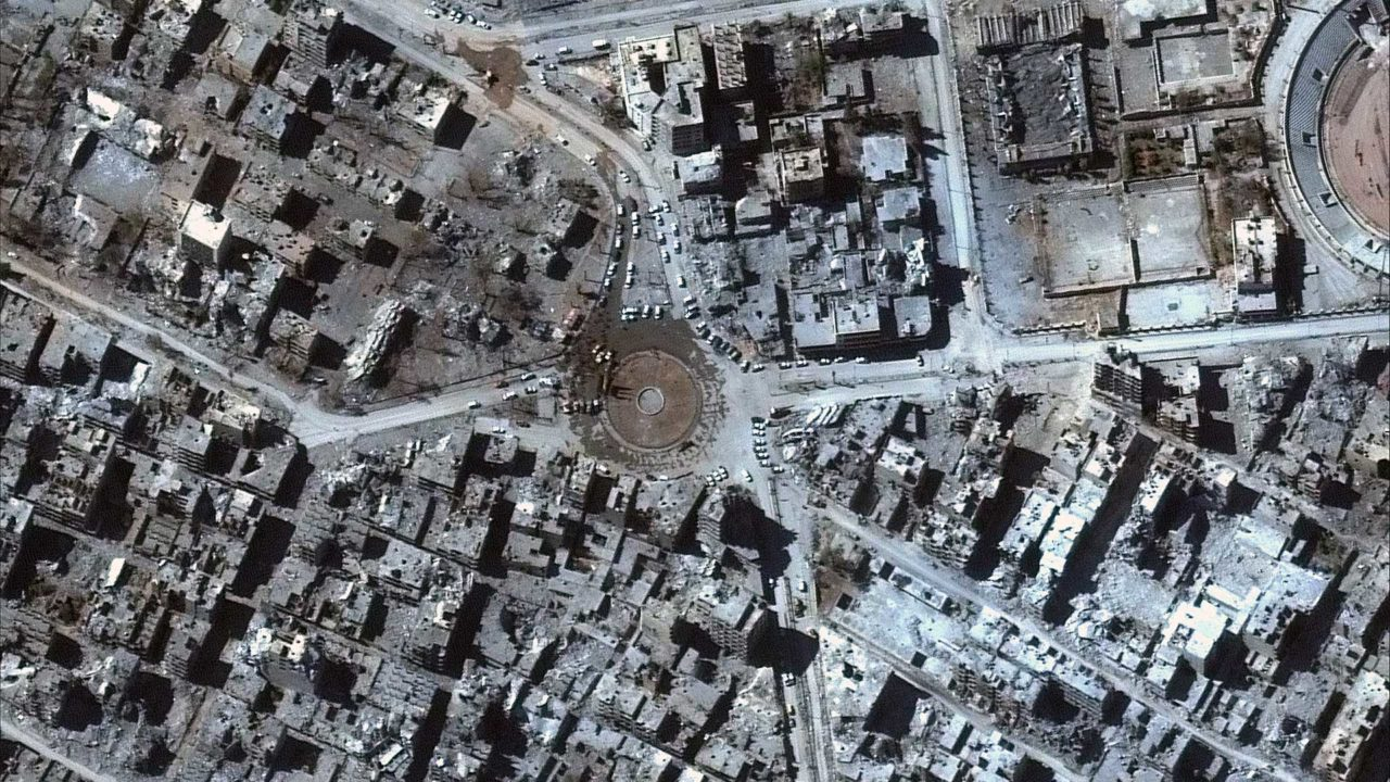 DigitalGlobe's WorldView 2 satellite captured this image of Syrian forces gathered in Raqqa's iconic Al-Naim square surrounded by the ruins of destroyed buildings. Photo: DigitalGlobe.