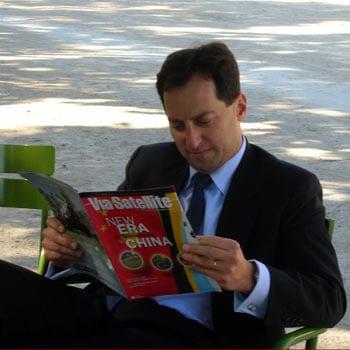 Dan Goldberg reading Via Satellite in 2008.