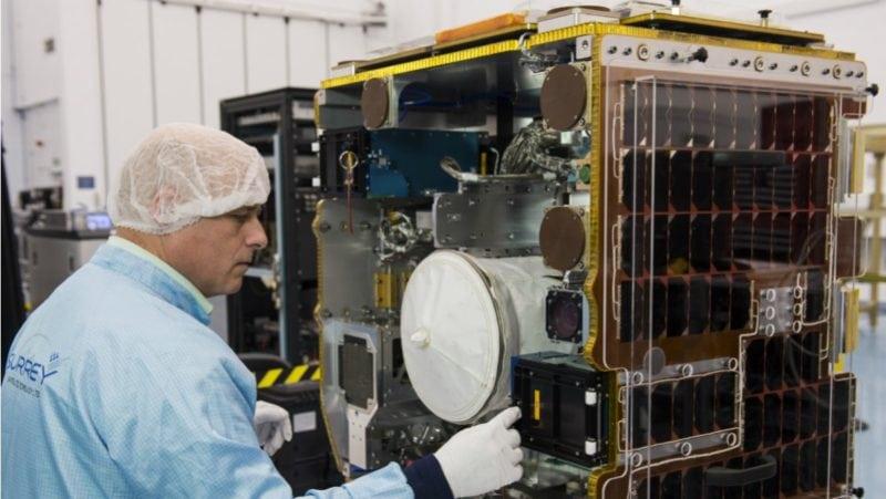 A University of Surrey engineer inspects the RemoveDebris spacecraft. Photo: University of Surrey/Matt Alexander.