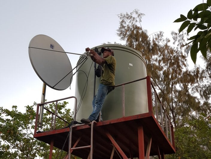 Installation of VSAT terminal at SAMES, Dili. Courtesy of Kacific Broadband Satellite.