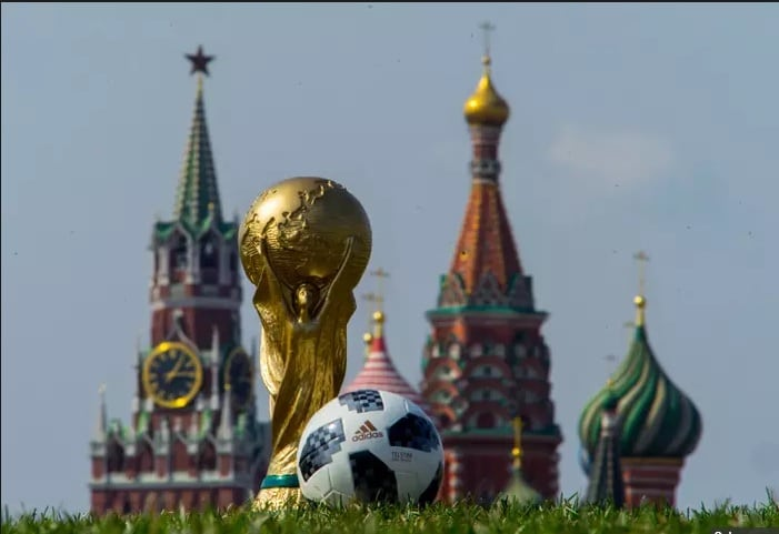 The FIFA World Cup and official ball with Moscow's Saint Basil's Cathedral as a backdrop.