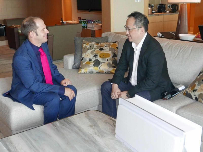 Mark Holmes (left) interviewing Tom Choi (right) in Singapore.