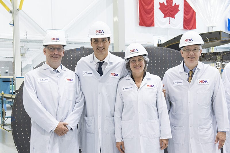 Canada Prime Minister Justin Trudeau joins MDA leaders to view the RADARSAT Constellation Mission satellites. Photo: Business Wire