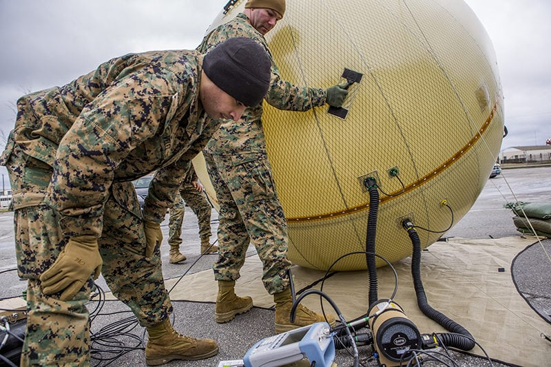 A Ground Antenna Transmit and Receive (GATR) inflatable satellite antenna being adjusted. Photo: U.S. Marine Corps/Lance Cpl. Joshua W. Brown