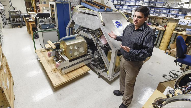 Orbital Micro Systems' Michael Hurowitz at the University of Colorado Boulder lab, where the company's weather satellite instruments are developed. Photo: Denver Business Journal
