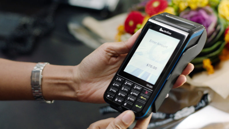 A person using a Verifone card reader. Photo: Business Wire