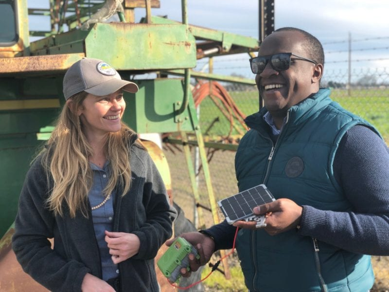 Stephanie Tatge, ecosystem services analyst for The Freshwater Trust and Nathan B Wangusi, technical lead for Water Research, IBM Research - Africa, holding a low-cost satellite sensor from SweetSense. Photo: IBM