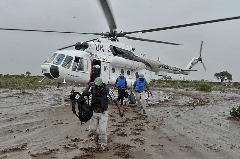 United Nations workers in Somalia disembark from an Mi-8MTV helicopter in November 2014. Photo: United Nations