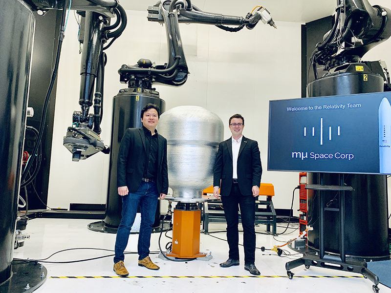 Mu Space CEO and Founder James Yenbamroong and Relativity Space CEO and Founder Tim Ellis stand in front of Relativity's Stargate, the world's largest metal 3D printer. Photo: Business Wire