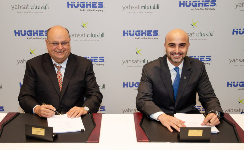Pradman Kaul, President of Hughes, and Masood M. Sharif Mahmood, Yahsat's Chief Executive Officer, make the companies' new joint venture agreement official at SATELLITE 2019 in Washington, D.C. Photo: PRNewsfoto/Hughes Network Systems