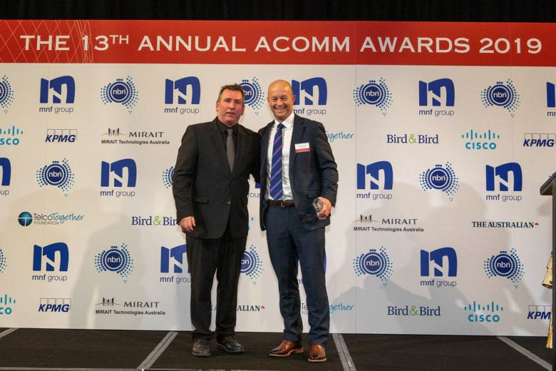 Hamish Lee, VP Sales APAC, Speedcast, receiving the ACOMM award. Photo: Speedcast